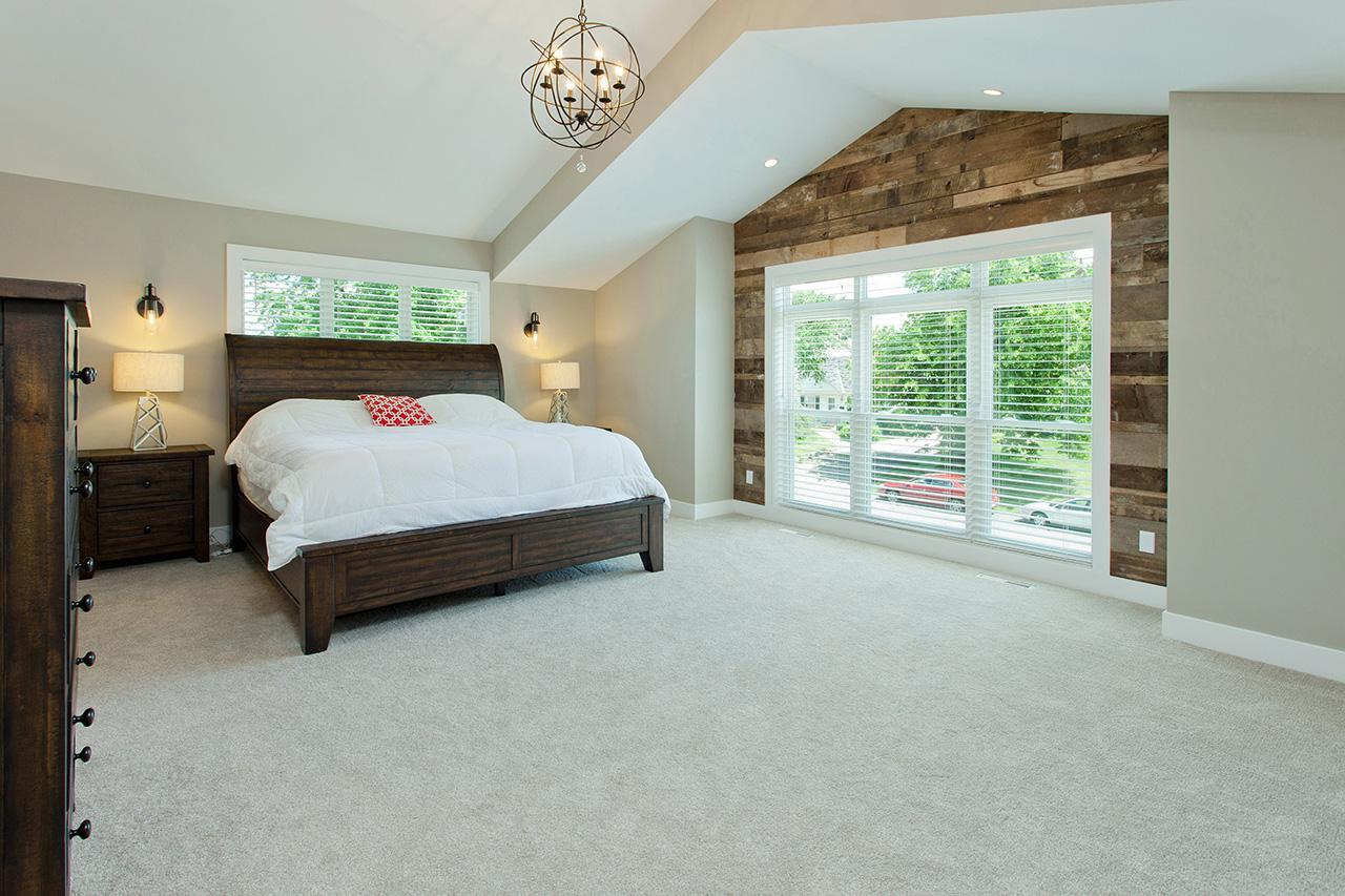Master suite at 5920 Zenith Ave. with reclaimed wood accent wall.